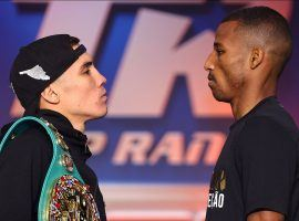 Oscar Valdez (left) will defend his WBC super featherweight title against Robson Conceicao (right) in a rematch of a 2009 amateur championship fight. (Image: Mike Williams/Top Rank/Getty)