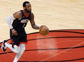 John Wall from the Houston Rockets during transition against the Miami Heat last season. (Image: Getty)
