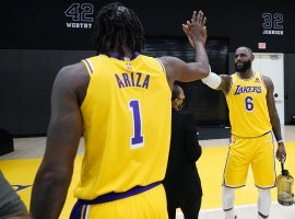 Trevor Ariza high-fives LeBron James during the Los Angeles Lakers media day last week in El Segundo. (Image: Getty)