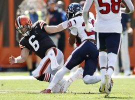 Cleveland Browns quarterback Baker Mayfield fails to tackle Justin Reid from the Houston Texans after an interception in Week 2. (Image: Ron Schwane/AP)