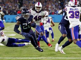Derrick Henry from the Tennessee Titans, who were home dogs against the Buffalo Bills on Monday Night Football, scampers for a touchdown. (Image: Wade Payne/AP)