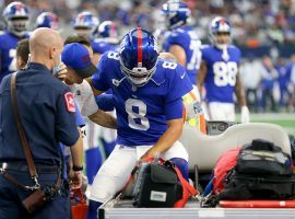 New York Giants quarterback Daniel Jones gets assistance to the medical cart after suffering a concussion and head injury against the Dallas Cowboys. (Image: Richard Rodriguez/Getty)