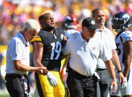 Trainers from the Pittsburgh Steelers assist wide receiver JuJu Smith-Schuster off the field after a shoulder injury knocked him out of Week 5. (Image: Joe Sargent)