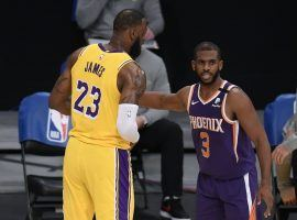 Chris Paul (right) from the Phoenix Suns guards LeBron James of the Los Angeles Lakers during the first round of the 2021 Western Conference playoffs. (Image: Getty)