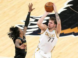 Dallas Mavericks star Luka Doncic (77) shoots a 3-pointer over Ja Morant from the Memphis Grizzlies. (Image: Nelson Chenault/USA Today Sports)