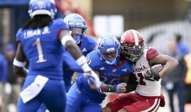 Oklahoma comes from behind to beat Kansas on Saturday, doing enough to keep their national championship hopes alive. (Image: Ian Maule/Tulsa World)