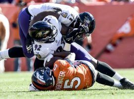 Teddy Bridgewater of the Denver Broncos hits the turf in the second quarter against the Baltimore Ravens, and did not finish the game due to a head injury and concussion. (Image: AAron Ontiveroz/Getty)
