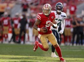 Rookie quarterback Trey Lance scrambles against the Seattle Seahawks in Week 4 after Jimmy G went down with an injury. (Image: Ezra Shaw/Getty)