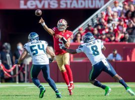 Rookie quarterback Trey Lance from the San Francisco 49ers evades a pair of Seattle Seahawks defenders after replacing Jimmy G, who went down with an injury. (Image: Getty)