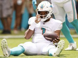 Miami Dolphins quarterback Tua Tagovailoa gathers himself after the porous offensive line allowed a sack. (Image: Getty)