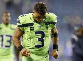 Seattle Seahawks quarterback Russell Wilson jogs off the field after he incurred a finger injury a loss against the LA Rams on Thursday Night Football. (Image: Porter Lambert/Getty)