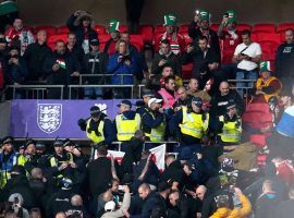 Police fought a few Hungarian fans at Wembley following a racist incident in the stands. (Image: msn.com)