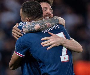 Mbappe and Messi hug after a PSG goal